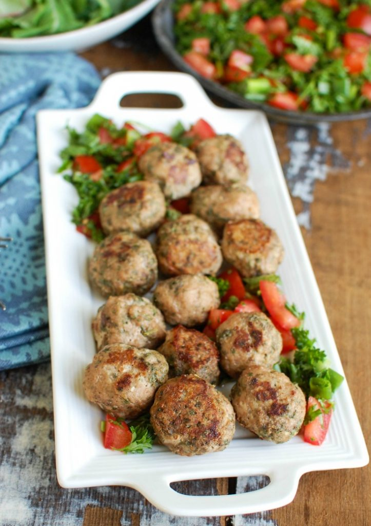 Mediterranean Baked Turkey Meatballs are turkey meatballs mixed with the warm, rich spices of cumin, cinnamon, allspice and cayenne pepper. These meatballs are lean and baked to create a healthy meal option. Pair these with fresh Mediterranean ingredients to create a rice bowl for dinner!