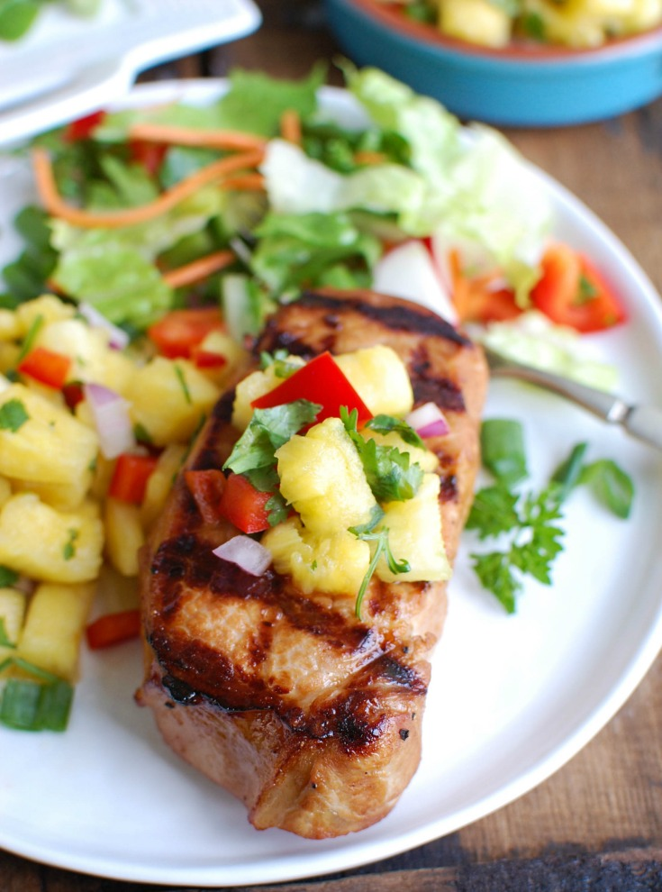 Grilled Hawaiian Pork Chops make a flavorful and easy summer meal that the whole family will love. Pork chops are marinated in a Hawaiian sauce, grilled to perfection and topped with a sweet pineapple salsa.