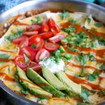 One Pot Beef Enchilada Casserole cooks in one pot to make the perfect quick and easy meal for back-to-school and those busy weeknights. It takes your favorite enchiladas and creates a casserole with ground beef, enchilada sauce, tortillas, vegetables and cheese. The kids and adults go crazy for this!
