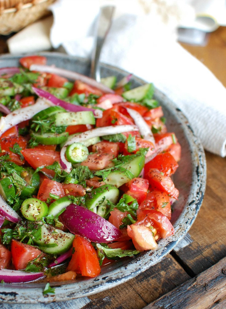 Persian Tomato Cucumber Salad is a fresh, light salad mixing tomatoes, cucumber, red onion, jalapeño, fresh mint and parsley and topped with an olive oil lemon dressing. This is the perfect side dish to any dinner or a nice lunch with some added chickpeas or grilled chicken.