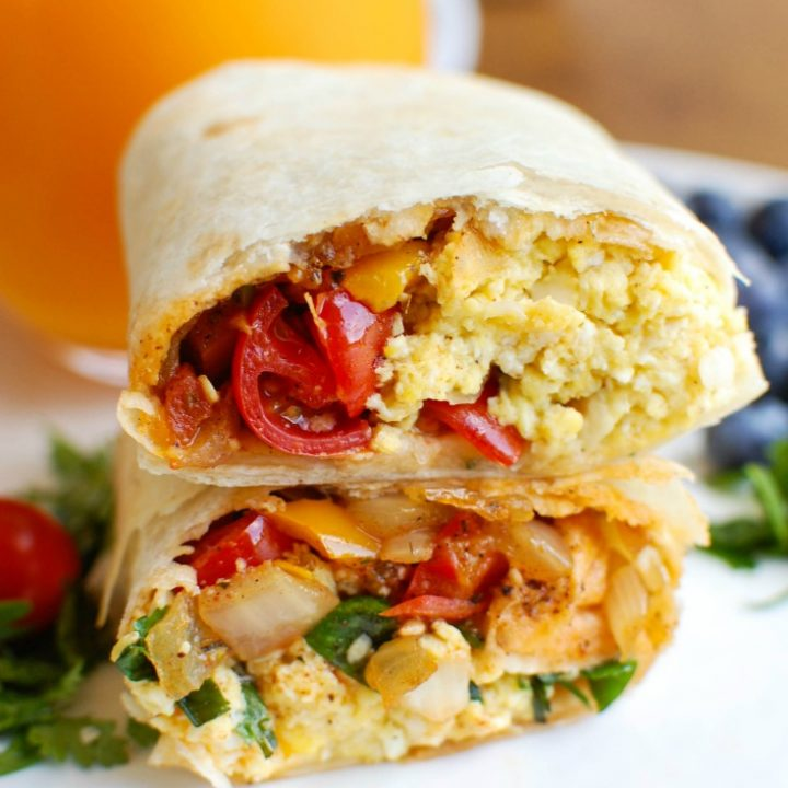 Vegetarian Breakfast Egg Burritos are a nice make-ahead breakfast for those busy days, especially during the school year. These breakfast burritos are loaded with veggies, eggs and cheese along with warm Southwestern spices. Make a big batch of these burritos and freeze them for later!