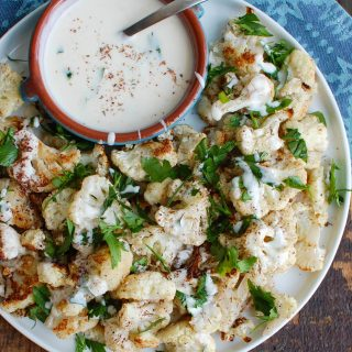 Za'atar Roasted Cauliflower with Yogurt Tahini Sauce takes your normal roasted cauliflower to a new level. Earthy and slightly sweet the za'atar is the perfect spice to add to your roasted cauliflower and is complimented nicely by the yogurt tahini sauce.
