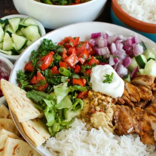Take your weeknight meals to a new level with these Chicken Shawarma Rice Bowls. Simple to make, packed with healthy and delicious ingredients, these rice bowl will take you away to the Mediterranean. Basmati rice is topped with chicken shawarma, tabbouleh, red onion, hummus, yogurt and lettuce to make the perfect meal.