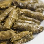 Always a crowd pleaser, these meat- stuffed grape leaves are delicious warm, cold or room temperature. My mom loves to add celery stalks and a couple of cabbage leaves to the pot for added avor while cooking.