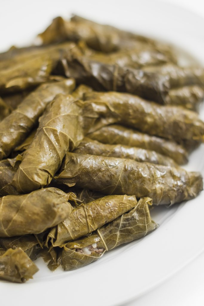 Always a crowd pleaser, these meat stuffed grape leaves are delicious warm, cold or room temperature. My mom loves to add celery stalks and a couple of cabbage leaves to the pot for added flavor while cooking.