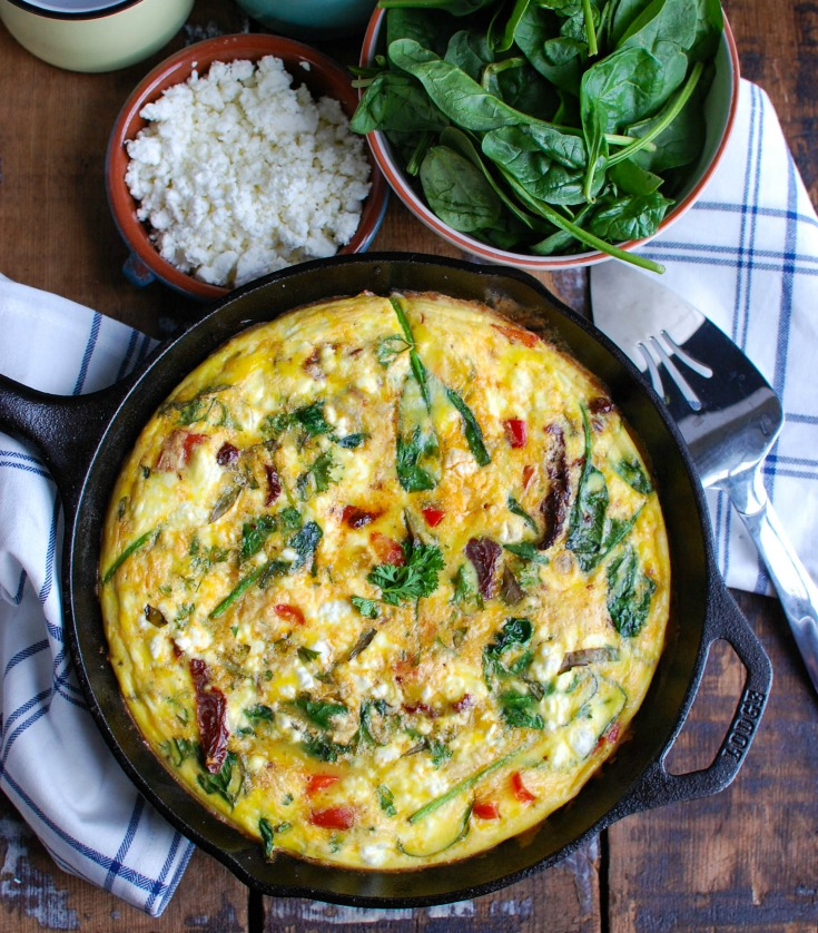 Sun-Dried Tomato Goat Cheese Frittata is a savory breakfast packed with healthy, filling ingredients. Sun-Dried tomatoes, spinach, red bell pepper, goat cheese and eggs are cooked and then baked to perfection. Serve this at a brunch or make it ahead of time for a quick weekday breakfast.