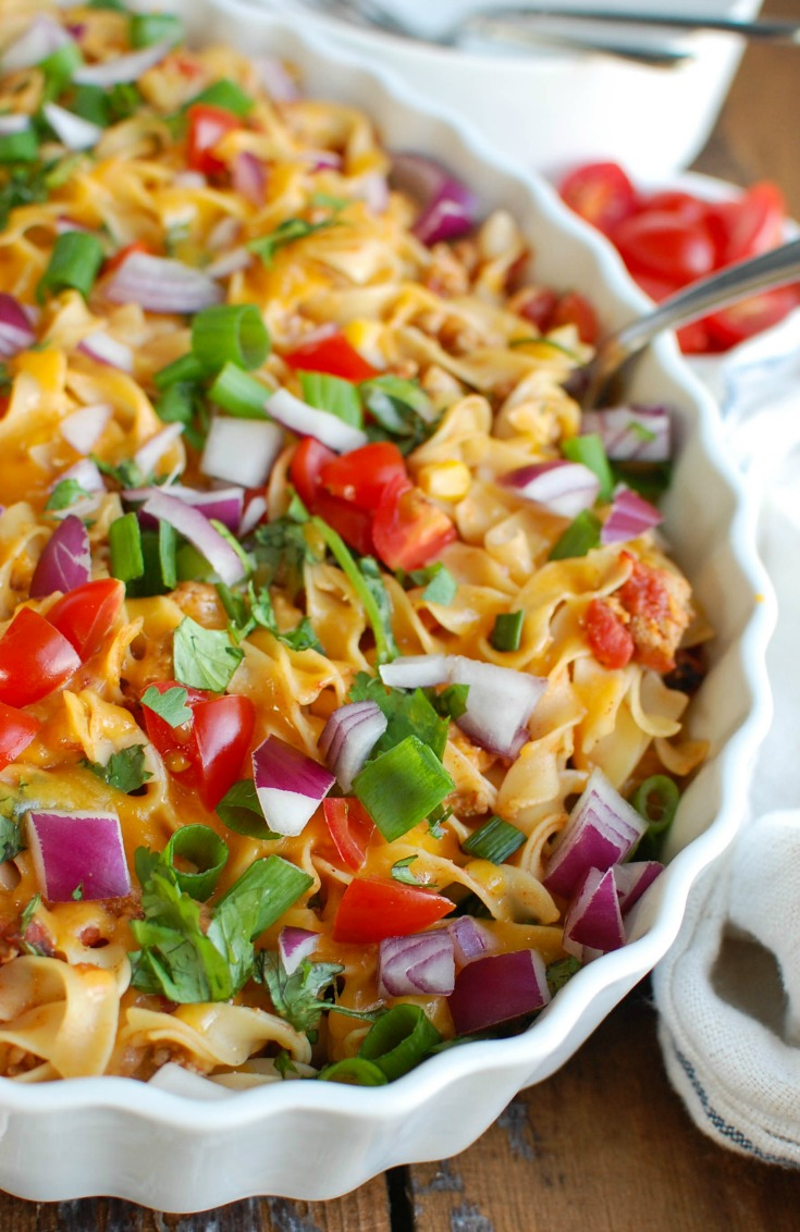 Easy Mexican Noodle Casserole makes weeknight meals easy, fun and festive with a colorful casserole packed with No Yolk Noodles,  colorful vegetables, ground turkey, spices and cheese. This dish will quickly become a family favorite.