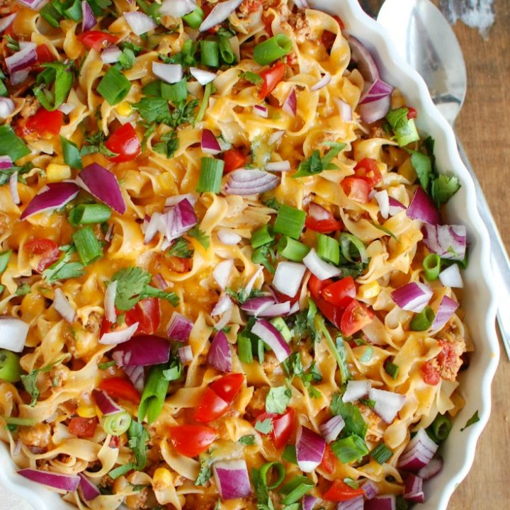 Easy Mexican Noodle Casserole makes weeknight meals easy, fun and festive with a colorful casserole packed with NoYolk Noodles, colorful vegetables, ground turkey, spices and cheese. This dish will quickly become a family favorite.