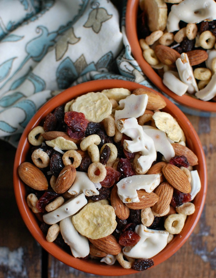 This Easy Breakfast Trail Mix makes a great on-the-go breakfast or snack mixing freeze dried bananas, almonds, dried fruit, yogurt pretzels, cereal and coconut. The kids love this along with the adults!