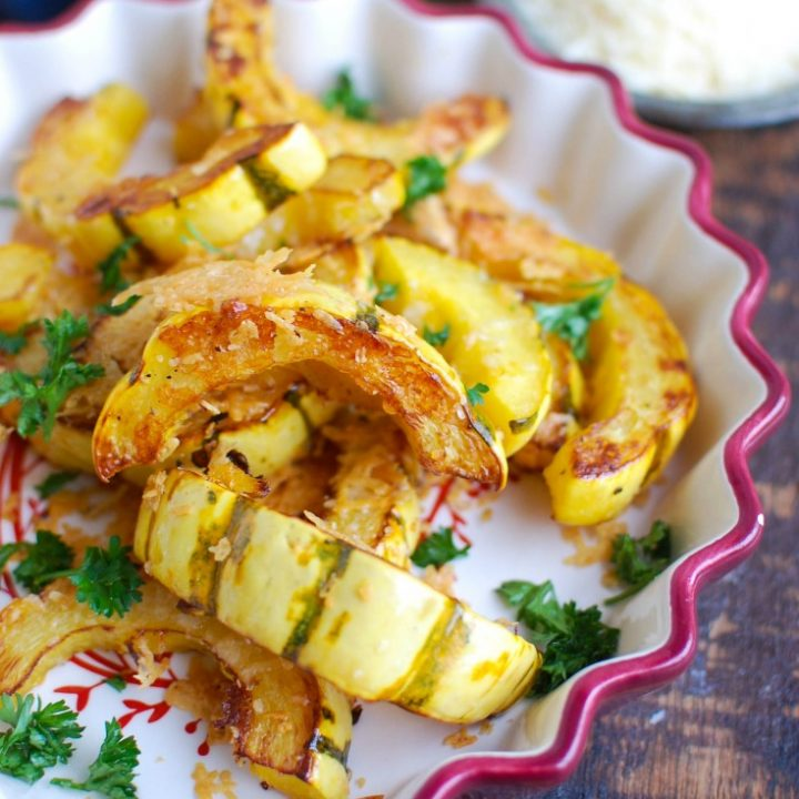 Roasted Parmesan Delicata Squash is sweet, savory and the perfect fall side dish.Delicata squash is roasted until soft and topped with parmesan cheese for the perfect flavor combination. This would also make awonderful holiday side dish!