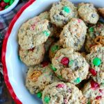 Peanut Butter Pretzel Chocolate Chip Cookies are made with creamy peanut butter and oats and loaded with pretzels, M & Ms and echolocate chips. These are a festive holiday cookie or perfect for any time of the year.