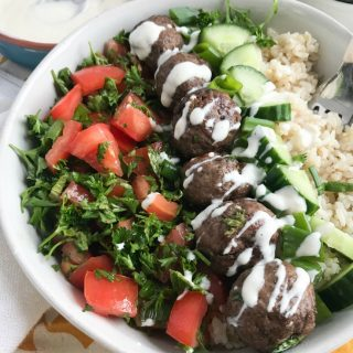 Beef Kafta Meatballs make a great dinner or an appetizer at a party. Ground beef {or you can use ground lamb} is mixed together with garlic, onion, parsley, mint and warm, rich spices. These meatballs make a great addition to a rice bowl with your favorite Mediterranean ingredients or paired with Lebanese Green Beans.