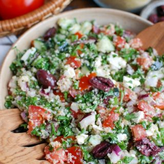 Greek Tabbouleh is a twist to classic tabbouleh using Greek ingredients. Kalamata olives, feta cheese, red onion and cucumber are paired with tomatoes, parsley, green onion and fresh herbs and topped with a light lemony dressing for a healthy salad.