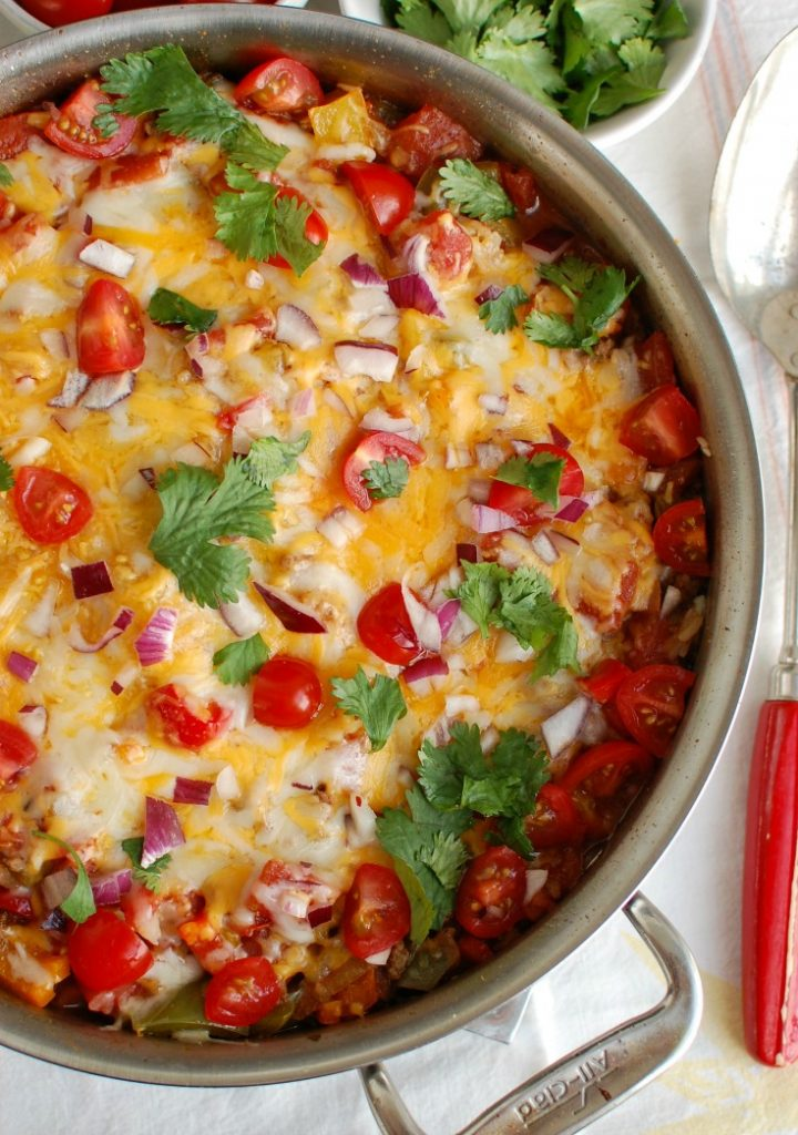 One Pot Mexican Stuffed Pepper Casserole is a zesty, comforting meal inspired by your favorite stuffed peppers. This one pot meal mixes a ground beef, a rainbow of bell peppers, rice, diced tomatoes and Mexican spices to create a comforting, healthy casserole.
