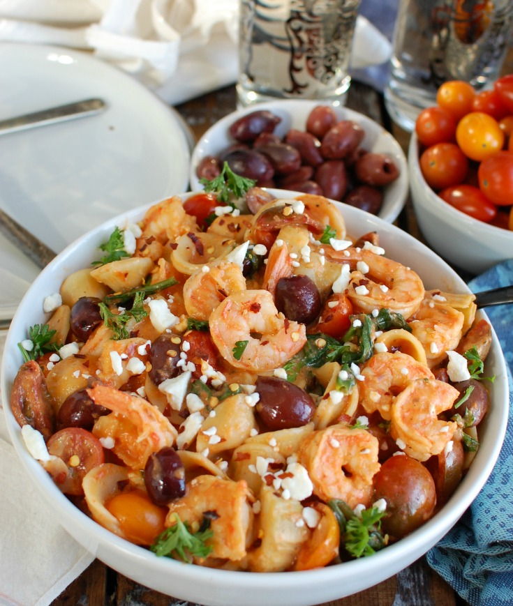 One Pot Mediterranean Shrimp Pasta is an easy one pot meal mixing shrimp with your favorite Mediterranean ingredients, pasta and a creamy roasted red pepper sauce. Shrimp pairs nicely with the fresh tomatoes, artichokes, kalamata olives, spinach and is topped with a creamy roasted red pepper sauce.