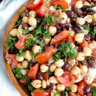 Balela Salad is a light and healthy salad mixing chickpeas, black beans, tomatoes, onion and parsley topped with a lemony sumac dressing with a hint of spice. This works great as lunch, as a side to dinner or topping to your pita, rice bowls or alongside grilled chicken or seafood.