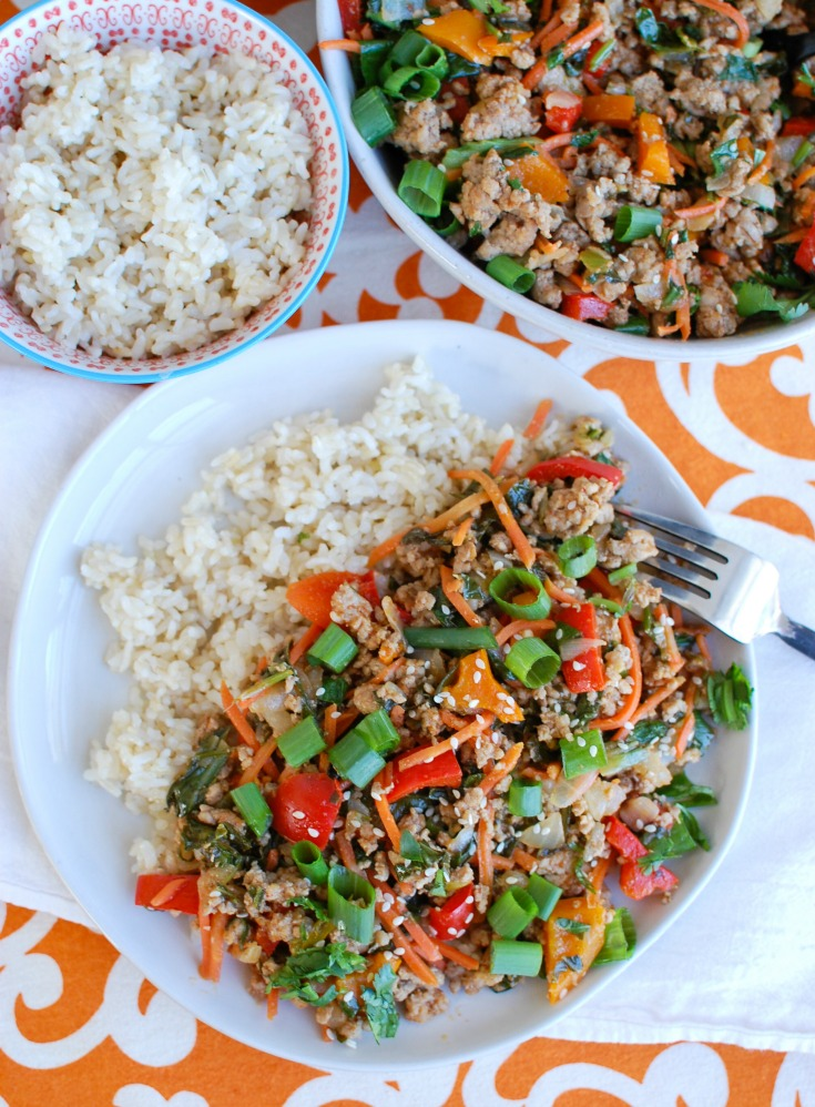 Easy Thai Pork Stir-Fry is a quick meal packed with your favorite Thai flavors. Ground pork is sautéed along with bell peppers, carrots and bok choy along with a sauce that is both spicy and sweet. This stir-fry works nicely with rice, noodles or in lettuce wraps.