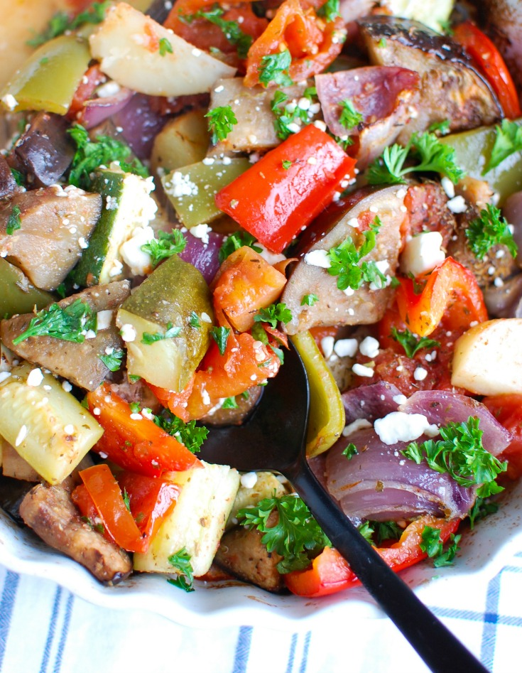 Greek Roasted Vegetables {Briami} are tender, flavorful vegetables that are roasted in a tomato based sauce and topped with fresh parsley and feta cheese. These vegetables work great over rice, paired with pasta or as a side dish to your meal.