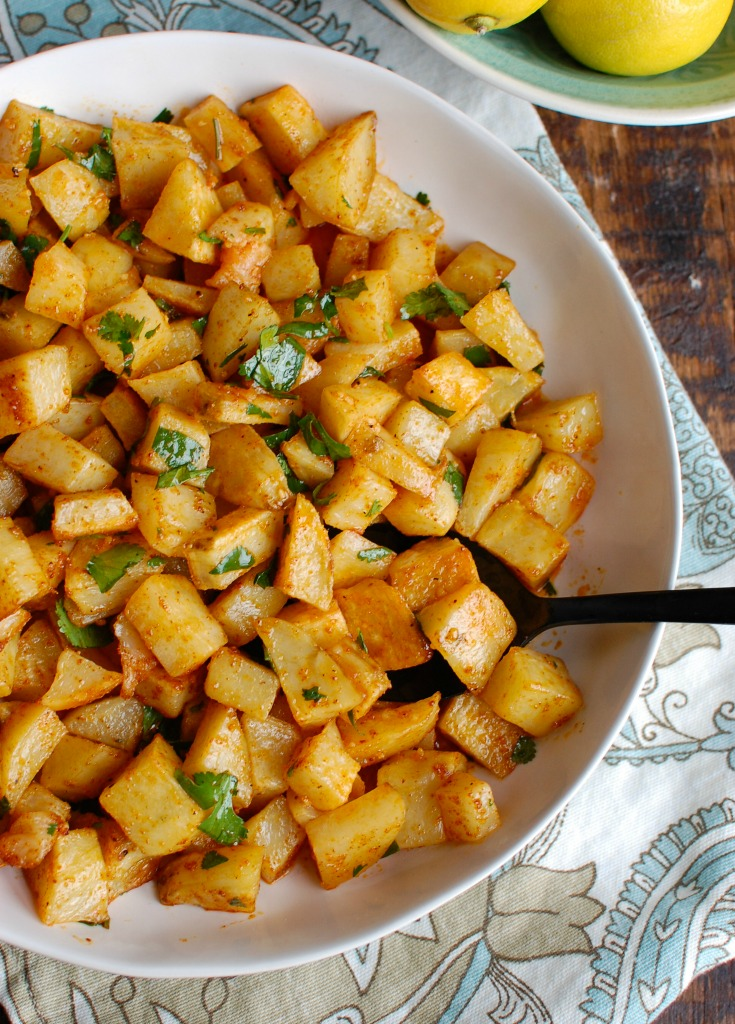 Spicy Lebanese Potatoes are crisp on the outside, tender on the inside and will spice up any meal. The sauce on these potatoes is the star featuring coriander, paprika, cayenne pepper mixed with olive oil and lemon juice. The dish is finished off with your favorite herb, cilantro or parsley.