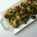 Brussels Sprouts with Cranberries on white plate