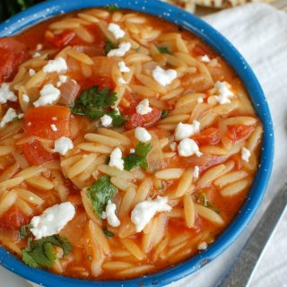 One Pot Creamy Tomato Herb Orzo in Blue Bowl