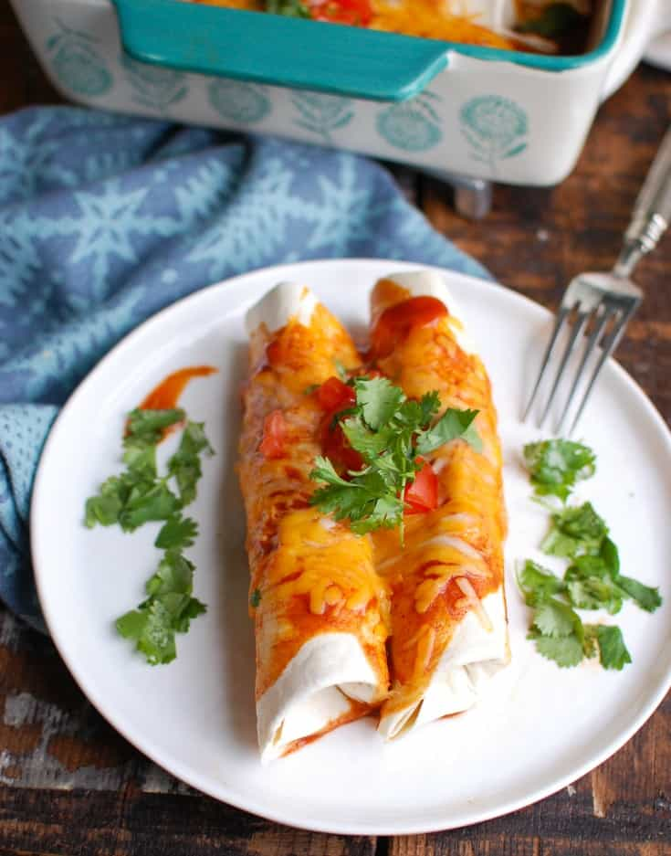 Three Cheese Beef Enchiladas on a white plate