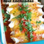 Three Cheese Beef Enchiladas in a pan up close