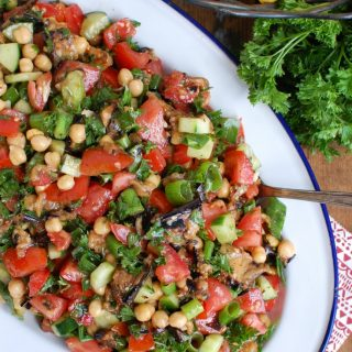Mediterranean Eggplant Chickpea Salad on White Blue Platter