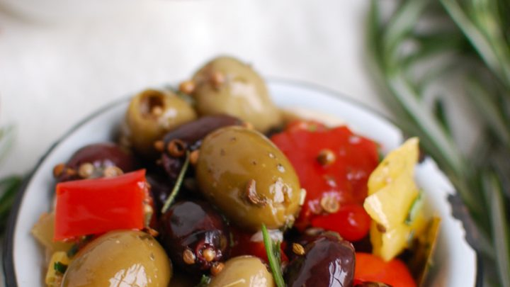 Lemon Marinated Olives in white bowl