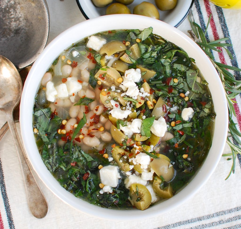 Navy Bean and Greens Soup with Feta and Olives Spoon