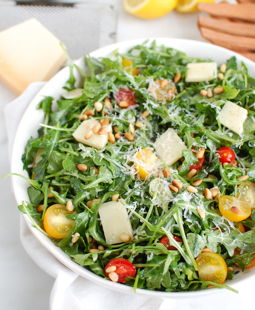 Lemon Arugula Salad with Pine Nuts with Wood Tongs