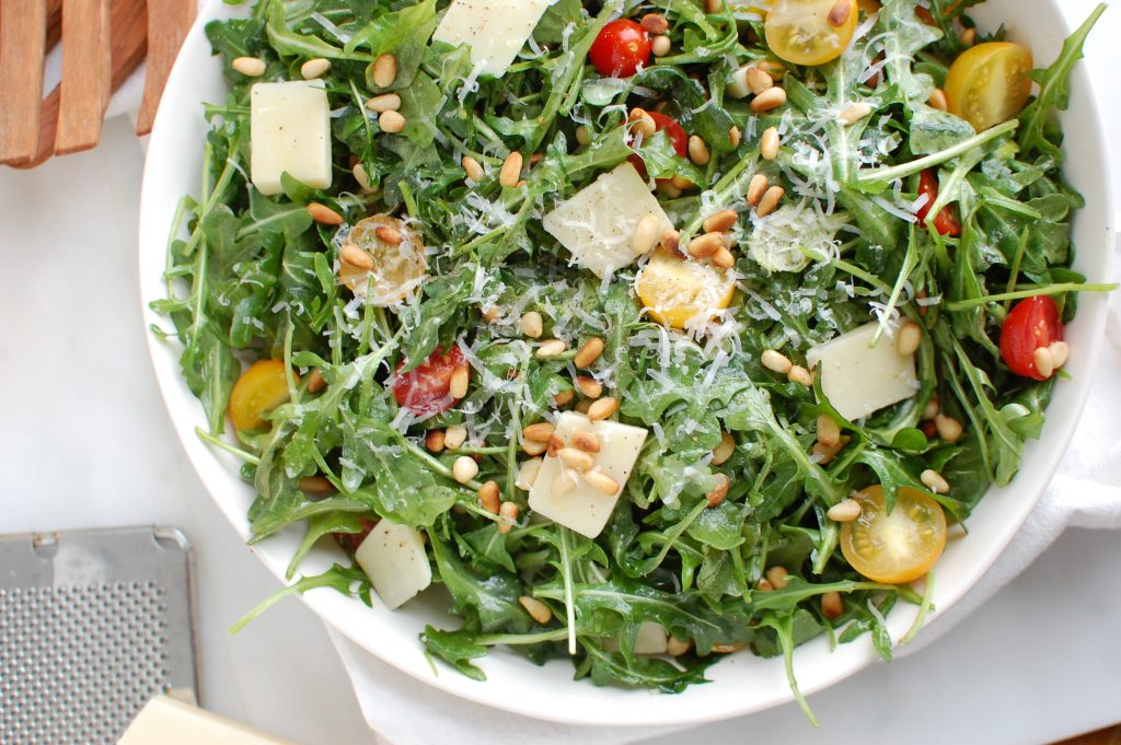 Lemon Arugula Salad with Pine Nuts in bowl