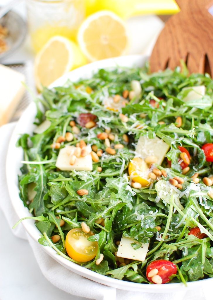 Lemon Arugula Salad with Pine Nuts White Bowl