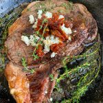 Pan-Seared Ribeye Steaks with Goat Cheese and Sun-Dried Tomatoes