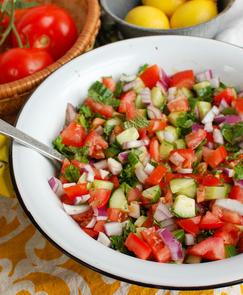 Israeli Salad in a Ceramic Bowl with Spoon