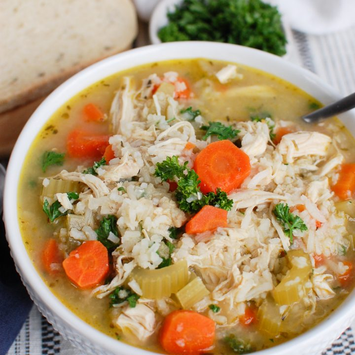 Slow Cooker Chicken and Rice Soup in White Bowl