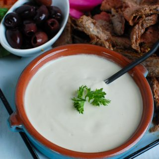 Tahini Sauce in teal dish