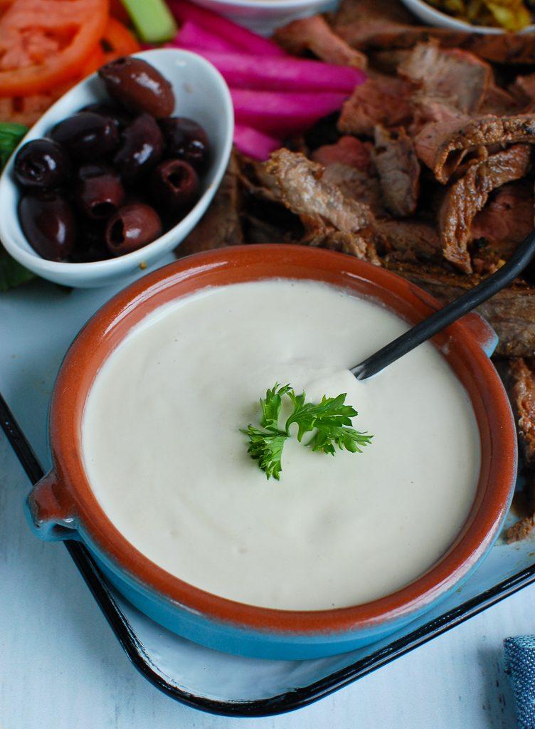 Tahini Sauce in teal dish