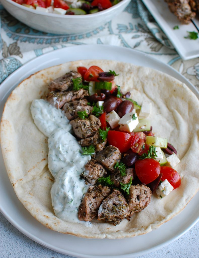 Pork Souvlaki with Tzatziki on a white pita