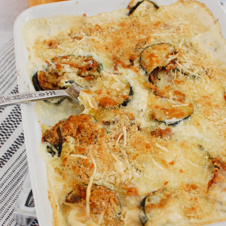 Zucchini Gratin in white casserole dish