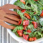 Arugula Salad with Capers with wood tongs