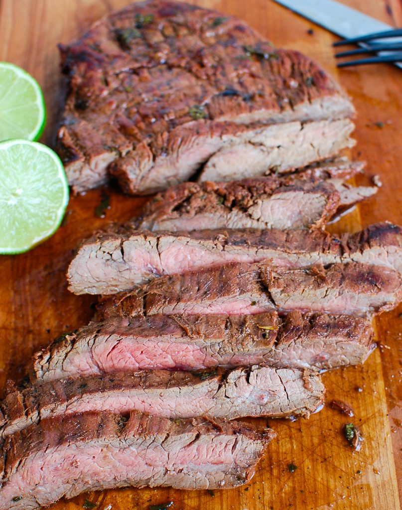 Grilled Carne Asada on cutting board with knife