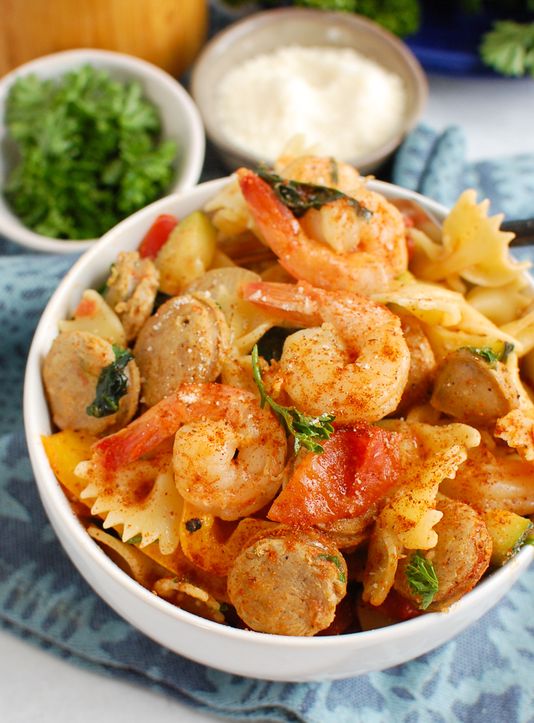 Cajun Pasta with Chicken Sausage and Shrimp in a white bowl