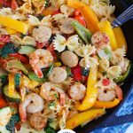 Cajun Pasta with Chicken Sausage and Shrimp in black skillet