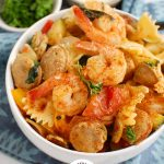 Cajun Pasta with Chicken Sausage and Shrimp with teal napkin