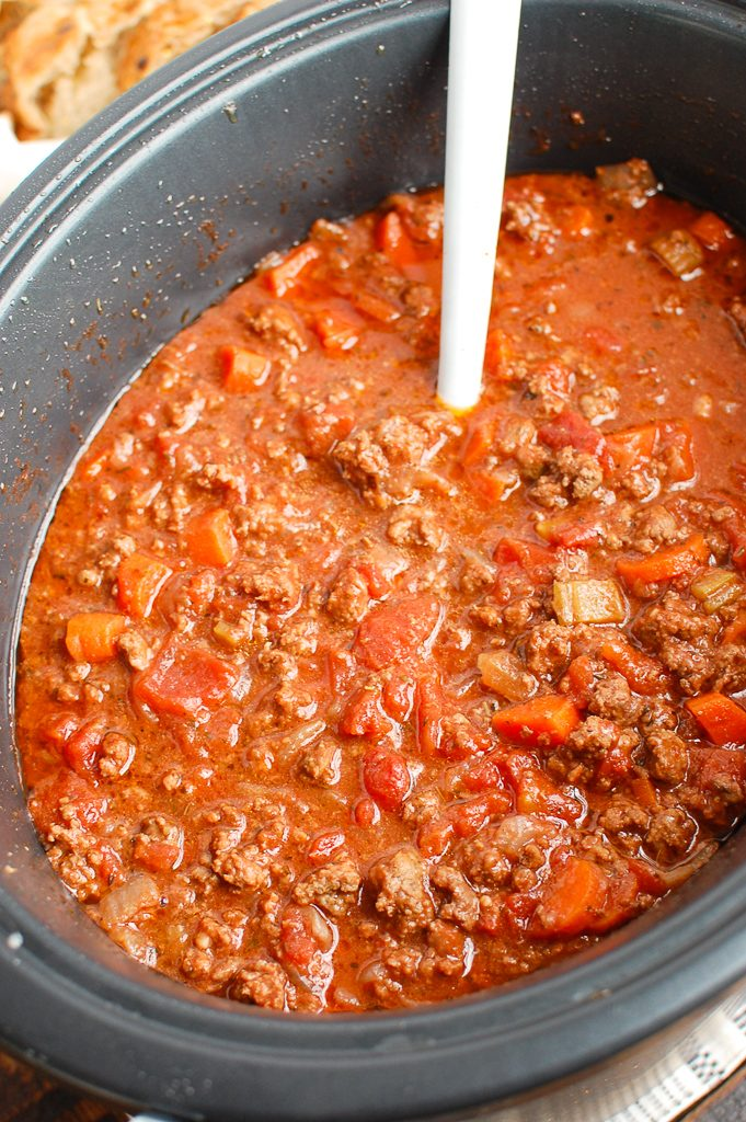 Slow Cooker Spaghetti Sauce with a white spoon
