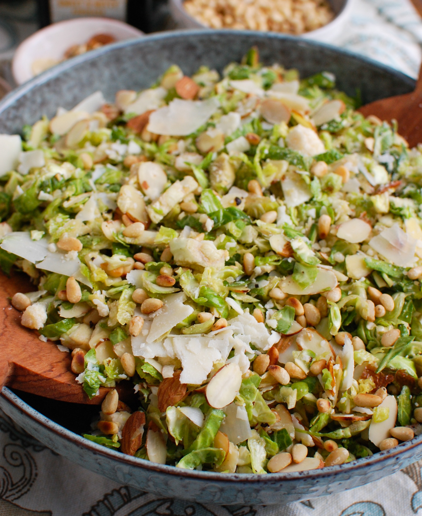 Shaved Brussels Sprouts Salad in a blue bowl