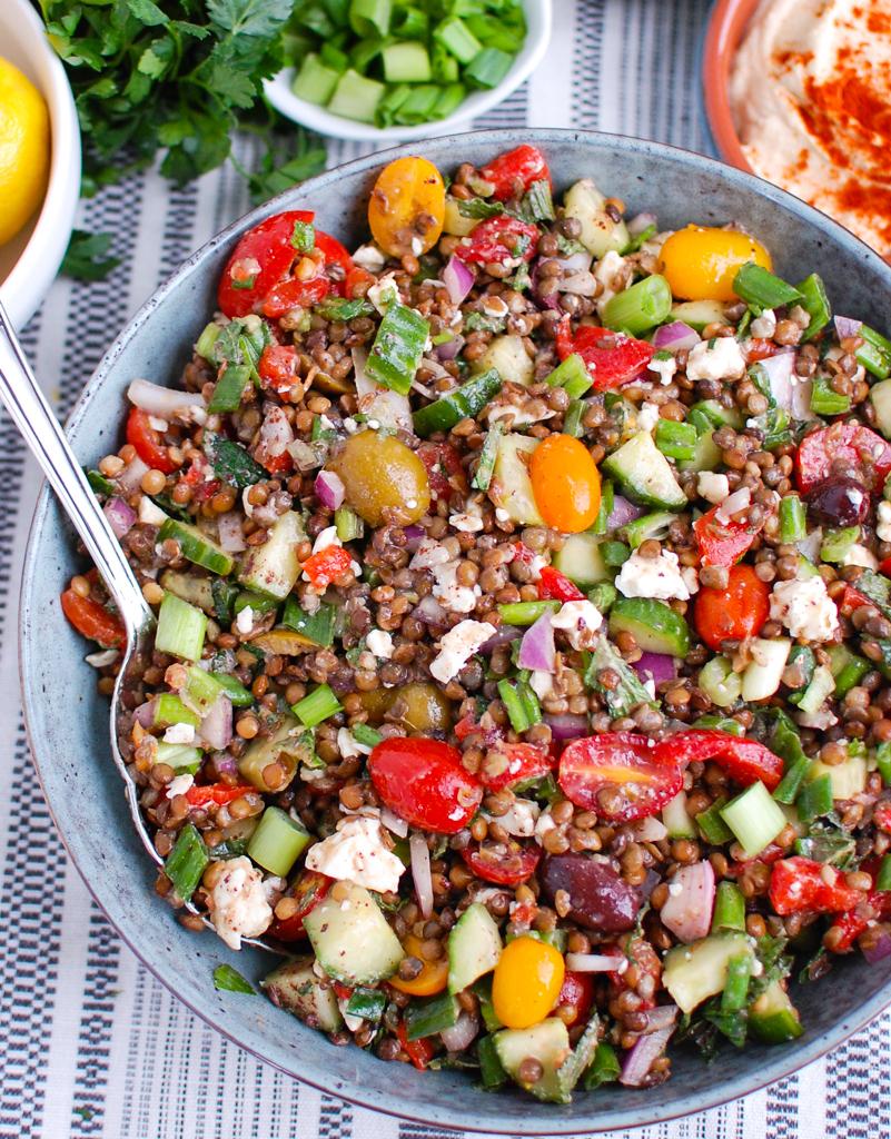 Mediterranean Lentil Salad in teal bowl