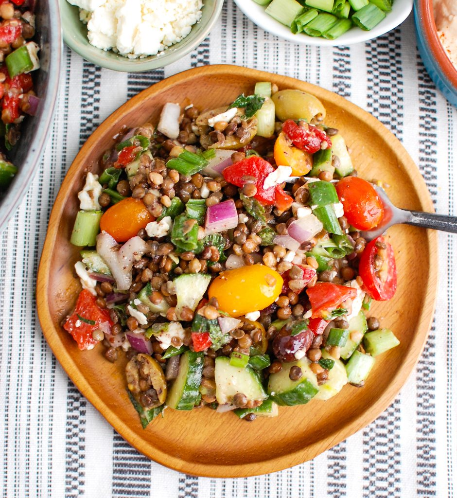 Mediterranean Lentil Salad on a wooden bowl