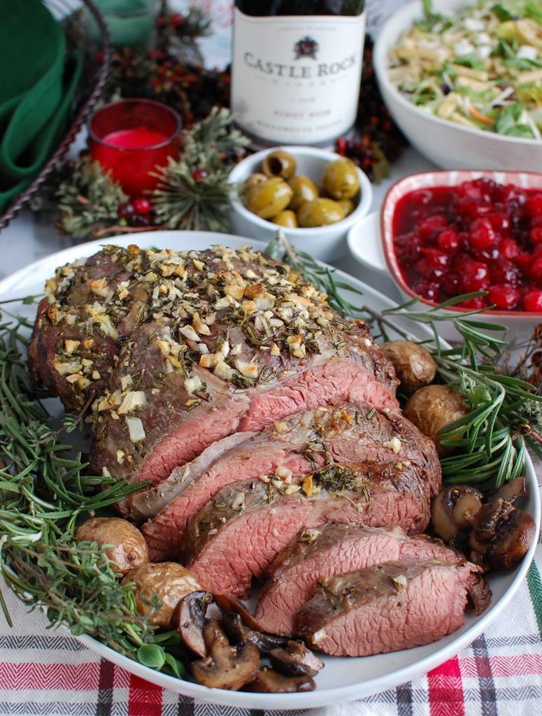 Rosemary and Garlic Roast Beef on a white platter